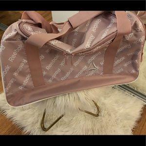 Pink Reebok medium sized gym duffle bag